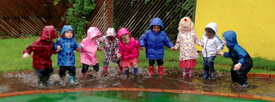 Children Smashing Puddles